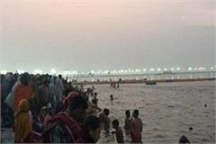 paush purnima bathing devotees are immersing faith in triveni