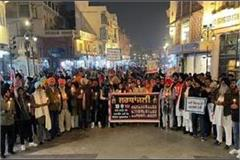 candle march organized to pay tribute to farmers