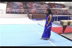 young woman doing a difficult stunt in gymnastics wearing a sari