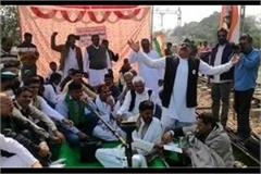 up farmers sitting on railway tracks with tents dance