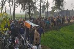 up dead body of deceased farmer wrapped in tricolor fir