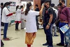 up corona check at the airport for passengers coming from maharashtra kerala
