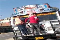 youth hanging in front of truck in morena