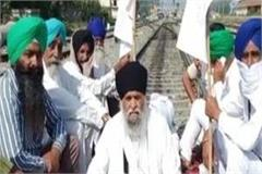 farmer sitting on railway track in ferozepur train stopped