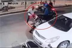 bike riding youth firing at shop incident captured in cctv