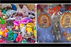 holi market of colors is decorated attracting people  modi pichkari