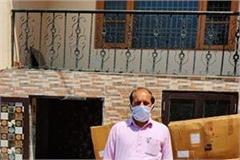 distribute ppt kits and masks to general public to corona warriors in hamirpur