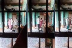 video viral of elderly man being beaten with slippers and pole