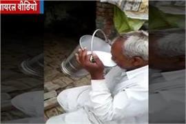 drink milk challenge in haryana old man drunk one bucket milk video viral