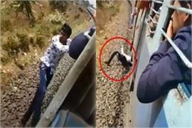 boy hanging out doing stunts from moving train