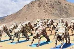 police personnel perform yoga in northern ladakh