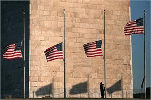 paris to honor the victims of the attack by the us bowed flag