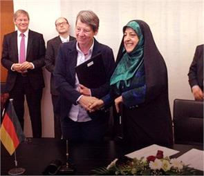 iranian minister under fire for touching a german man
