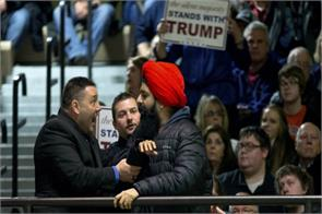sikh man forced out of trump rally for carrying stop hate banner