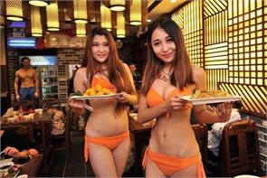 chinese food street hires bikini model to sell its snacks