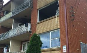 mother drops baby and toddler from window to escape lakemba unit fire
