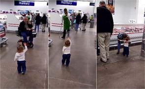 adorable kid goes around supermarket greeting strangers in viral video