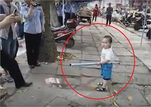 uighur boy attacks inspectors to defend the family business