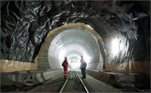world longest rail tunnel sees light at end of decades wait