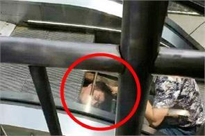 technician stuck in the moving escalator in chongqing city of china