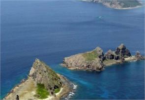 japan protests as chinese navy sails near disputed isles summons ambassador