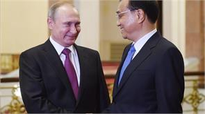 putin praises all embracing partnership of russia china