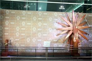 worlds largest wooden charkha at igi airport
