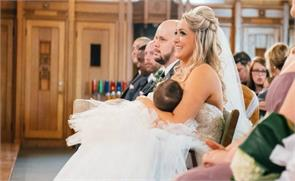 this photo of a bride breastfeeding during her wedding ceremony is going viral