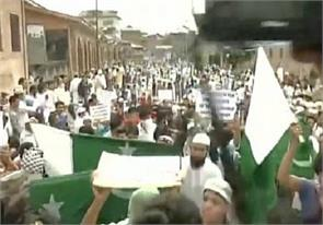 at a rally in pakistani kashmir flag waving