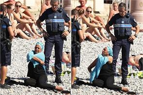 french policemen force a woman to remove her burkini