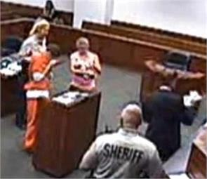 inmate meets his son for the first time in court