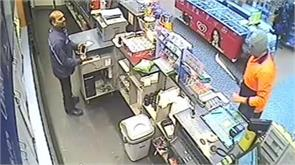 indian origin store attendant's terrifying moments captured on camera
