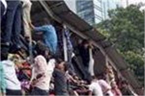 rain to blame for mumbai stampede that killed 23 says report