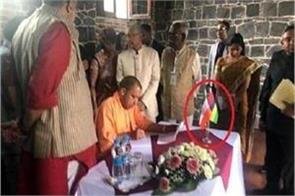 yogi paused on tour of mauritius paused photo in front of the reverse tricolor