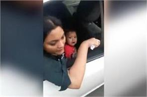 mother was feeding the baby in the car police pulled the car from crane