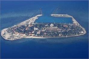 china unveils massive   magic island maker   dredging vessel
