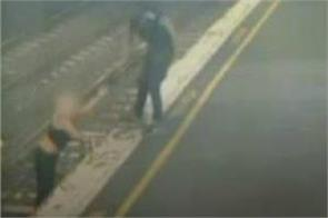 woman facing the death crossing the railway track