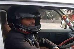 this man wearing helmets for driving car