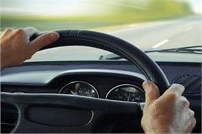 woman screaming while driving a car