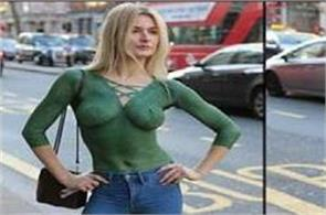 beautiful  walks topless on busy road in london