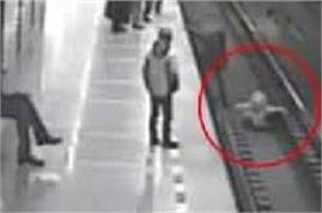 real life hero video viral man jumping on train tracks to save boy