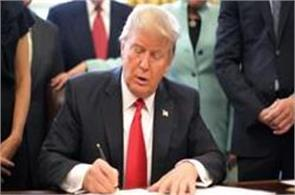 trump signs order aimed at removing   job killing regulations