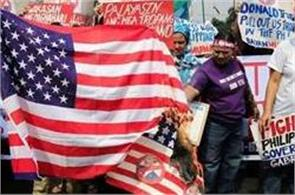 women  s group in manila burns us flag with trump  s face