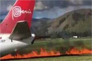 passenger plane bursts into flames during emergency landing in peru