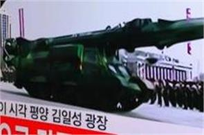 north korea displays intercontinental ballistic missiles at parade