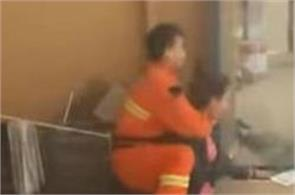 chinese firefighter rescued a woman who trying to jump from 15th floor