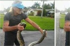 man wrestles python to save dog
