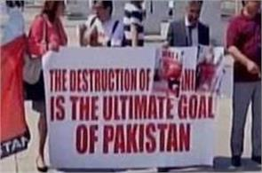 geneva balochs protest against pak atrocities in front of iconic broken chair