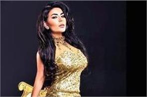 afghan singer burns   naked   outfit she wore at paris concert