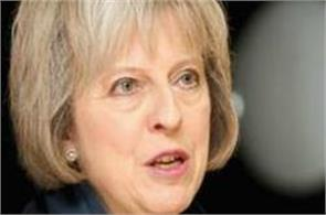 after losing majority in britain election theresa may out of party
